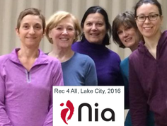 Picture of women smiling with red Nia logo